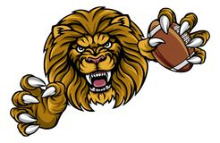 Lion American Football Ball Sports Mascot. A lion angry animal sports mascot holding an American football ball Royalty Free Stock Photo