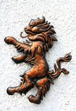 Lion bronze figure on the white wall Royalty Free Stock Photos