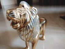 Lion. Bronze lion on floor Stock Photography