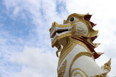 Lion in Buddhist religion. The large sculpture in front of the entrance of every  temple Royalty Free Stock Image