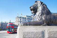 Lion and bus in Trafalgar square, London Royalty Free Stock Images