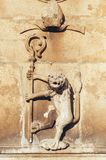 Lion Carved Sculpture Holding a Corsier. Symbol of Leão e Castela culture, Afonso II from Asturias Stock Images