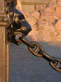 Lion and chain. Detail of a statue board fence Stock Image