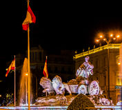 Lion chariot statue at Ciebeles Plaza with spanish flags Stock Images