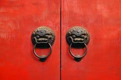 Lion chines door hand grip. On red chines door royalty free stock image