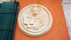Lion in circular shape bas relief art Royalty Free Stock Image