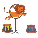 The lion in the circus jumps over the ring of fire.  Royalty Free Stock Photo