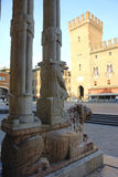 Lion and the City House Tower. View of the Ferrara City House tower from the entrance of the cathedral Stock Photo