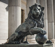 Lion of Congress. Statue of a lion at the entrance of the Congress of Deputies. It is made with molten war cannons seized from enemies iron. Madrid Stock Photos