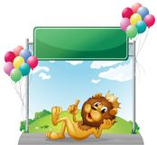 A lion with a crown near the empty signage Royalty Free Stock Photos