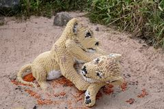 A lion cub  statue made from Lego bricks. CHESTER, UNITED KINGDOM - MARCH 27TH 2019: A lion cub  statue made from Lego bricks royalty free stock images