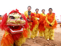 Lion dance actor. China's lunar New Year, a group of performance ShiZiWu actor, in the streets waiting for performance in February 2012, shot in baoji street in Stock Image