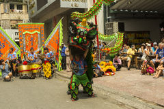 Lion dance. Ho Chi Minh,Vietnam. Before starting new business ritual called `Lion dance` against evil spirits is performed. It is custom that has origin in China Stock Images