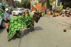 Lion dance. Ho Chi Minh,Vietnam. Before starting new business ritual called `Lion dance` against evil spirits is performed. It is custom that has origin in China Royalty Free Stock Photos