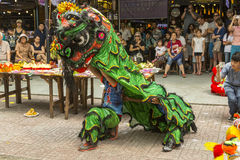 Lion dance. Ho Chi Minh,Vietnam. Before starting new business ritual called `Lion dance` against evil spirits is performed. It is custom that has origin in China Royalty Free Stock Images