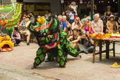 Lion dance. Ho Chi Minh,Vietnam. Before starting new business ritual called `Lion dance` against evil spirits is performed. It is custom that has origin in China Stock Photography