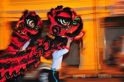 Lion dance at night. Taken with low shutter speed, panning and fill flash Stock Photos
