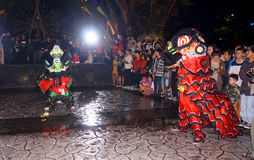 Lion dance. Performances enliven the Chinese culture in the city of Solo, Central Java, Indonesia Royalty Free Stock Photo