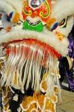 Lion Dancers på beröm av det kinesiska nya året i Blackburn Lancashire Arkivfoto