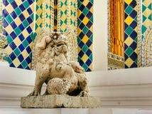 Lion-dog guardian & x28;komainu& x29; at the entrance of King& x27;s Palace in Bangkok, Thailand. Lion-dog guardian & x28;komainu& x29; at the Stock Photography