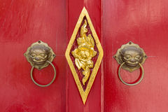 Lion door knob. In buddhist temple royalty free stock photography