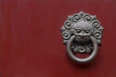 Lion door knocker. Chinese lion door knocker on black wooden gate royalty free stock image
