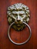 Lion door knocker on wooden door royalty free stock photos