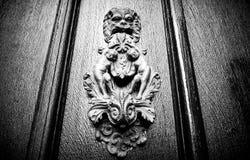 Lion on Door. Metal lion on door with bodies Stock Image