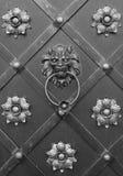 Lion doorknocker with ring. On metal door Stock Photo