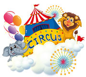 A lion and an elephant near the circus signage Stock Image