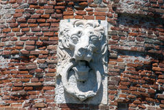 Lion emblem on the old red brick fortress in Livorno,Italy Royalty Free Stock Image