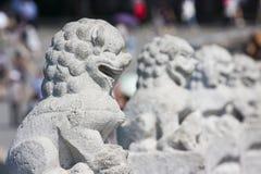 Lion en pierre asiatique Photos stock