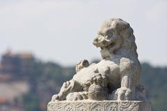 Lion en pierre asiatique Photographie stock libre de droits