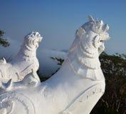 Lion en pierre blanc Photographie stock