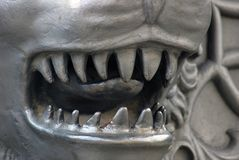 Lion face close-up. The King Cannon detail. Moscow Kremlin. It shows animal's head with open mouth and a longue seen through the teeth. Popular landmark Stock Photo