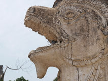 Lion face  statue and bird. Lion face statue and pigeon Stock Images