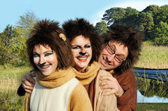 Lion family. Family in lion costumes outside in a park Stock Image