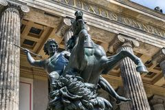 The Lion Fighter equestrian bronze statue by Albert Wolff from 1858 outside the Altes Museum in Berlin. Germany stock images