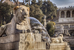 Lion fountain in Rome Italy Stock Images