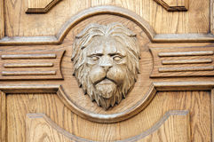 Lion fragment of an ancient carved door closeup Royalty Free Stock Photos