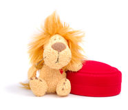 Lion with Gift. Little stuffed lion with small gift box over white background Royalty Free Stock Photography