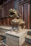 Lion guard in front of a temple royalty free stock photography