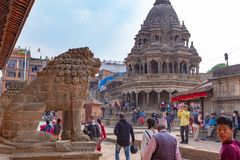 Lion guard, numerous visitors and an hinduist temple royalty free stock photography