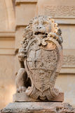 Lion guarding the main gate Royalty Free Stock Image