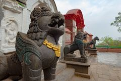 Lion guards near a buddhist monastery royalty free stock photo