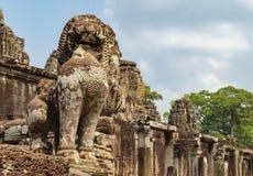Lion guards Prasat Bayon in Angkor Thom, Cambodia Royalty Free Stock Photo