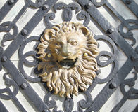 Lion head. Golden lion head at Peles Castle gate Royalty Free Stock Photography