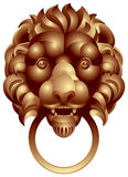 Lion head. With the ring in the mouth, ancient door handle, bronze or gold doorknob Royalty Free Stock Photos