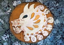 Lion head in circle, fragment, hot batik royalty free stock image