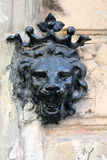 Lion head decoration. Crowned lion head decoration of the black color at the wall of an old  building in Odessa (Ukraine Royalty Free Stock Photography